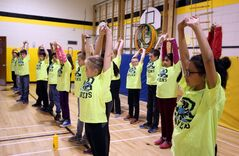 Riverview School students taking part in the Kilometre Club organized by Thomson stretch out before running during recess.