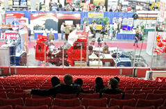 Visitors look over the show floor, which is now minus three government organizations that have pulled out while an advertising ban is in effect during the Morris and Arthur-Virden byelections.