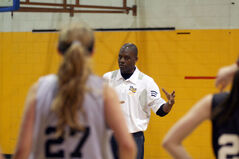 Novell Thomas, the head coach of the Bobcats women's basketball team, describes a drill to the players at the team's ID camp Saturday morning at the BU gym.