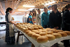 Grade 8 students from Waverly Park School tour the Deerboine Hutterite Colony kitchen as Mary Wurtz lays out freshly baked bread on Wednesday.