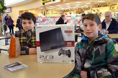 Hunter and Blake with a PlayStation 3 Hunter bought with his own money yesterday at Shoppers Mall.