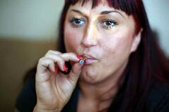 Jade Ridge smokes marijuana in the living room of her Brandon residence.