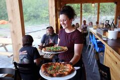 Erin Grimsley serves up some pizza at the Foxtail Cafe in Onanole.