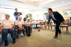 During his next stop, Trudeau plays bocce while visiting with residents at Victoria Landing seniors residence.