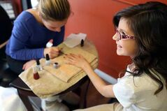 Ocean Haugh, a Grade 5 student at Meadows School, has her nails done by Jaidyn Werbowski at Platinum Designs earlier this week.