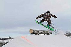 A snowboarder hits the trails at the Asessippi Ski Area and Resort.