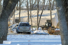 A tent used by the Brandon Police Service is erected near the banks of the Assiniboine River in Queen Elizabeth Park on Wednesday while officers investigate the discovery of a body.