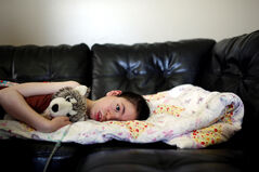 This photograph of 10-year-old Tatyanna Zazalak, who is living with late infantile Batten disease, a rare and fatal disorder that has robbed her of her sight, speech and ability to move so far, is one of 12 photos from Sun photographer Tim Smith's portfolio submission that garnered him a nomination for Photojournalist of the Year.