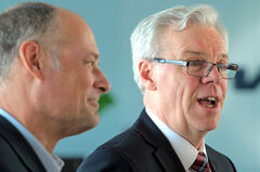 Premier Greg Selinger announces a series of infrastructure projects  as Brandon East NDP MLA Drew Caldwell listens at the Brandon Municipal Airport on Thursday.