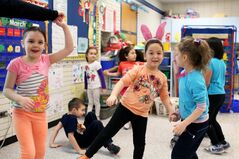 Students in Carole McCurry's full-day kindergarten class dance to music at George Fitton School. (Tim Smith/Brandon Sun)