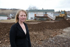 A dike is built to protect Shanna Turnbull's home as well as a nearby lift station for the town of Birtle from the rising Birdtail Creek on Saturday  afternoon. So far, 12 Birtle and area homes have received evacuation notices.