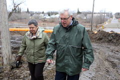 Riding Mountain MLA Leanne Rowat and Premier Greg Selinger tour homes along the north side of Birdtail Creek to get a look at flood protection measures in place to protect the homes, as well as the water treatment plant and lift station on Monday morning.