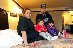 Elysia Shingoose and Lehon Bone of Waywayseecappo First Nation sit in their room at the Russell Inn  with their children Lenaya and Tizabeth on Monday.