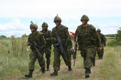 Soldiers from 2PPCLI share a laugh after a morning section attack practice in CFB Shilo.