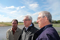 Agriculture Minister Ron Kostyshyn, left, Premier Greg Selinger and Brandon-Souris Conservative MP Larry Maguire speak with media on Tuesday in Brandon. The three toured flooded areas of Westman, including Deloraine and Melita.