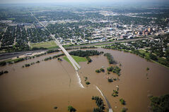 Floodwaters from the rising Assiniboine River cover First Street North in a couple places on Saturday.