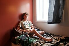 Eighteen-year-old Tyrrel Kline sits on his bed inside his suite at the new Youth For Christ U-Turn housing complex on 5th Street in downtown Brandon.