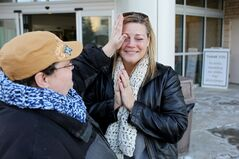 Friend Tammy Neilson wipes away tears as Sharon Ellerington celebrates leaving the Brandon Regional Health Centre after spending 84 days in hospital.