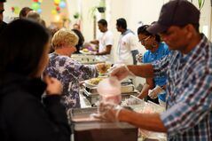 Visitors to the Mauritian Pavilion at St. Matthew's Cathedral are served up food from the island country during the Westman Multicultural Festival on Friday evening.