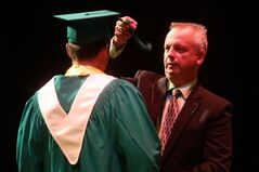 Principal Michael Adamski confers a student by passing the cap board's tassel to the left side during the June 2016 convocation ceremony for École secondaire Neelin High School at the Western Manitoba Centennial Auditorium.