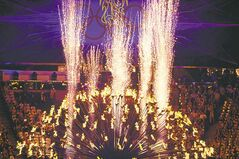 The Olympic cauldron is opened up before before  being  extinguished at the end of the games.