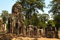 This is one of the crumbled entrance areas. It is possible to climb on this and the other places in Bayon except for two things. The security guards stationed against this kind of idiocy and how dangerous it is to climb up on something this old.