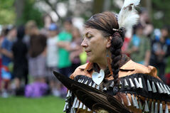 Roxanne Bone, director of Keesee Sharing Lodge, dances during the powwow, held on the shore of Clear Lake.