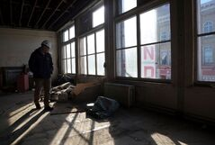 Brandon University physical plant manager Gord Neal walks on the second floor during a tour of the Strand Theatre site on Monday afternoon.