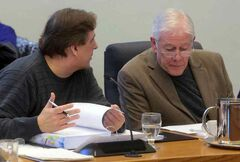 Councillors Shawn Berry, left, and Jim McCrae talk prior to Saturday afternoon's budget session at city hall.