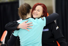 Brandon skip Kortney Teale hugs teammate Pam Robins after defeating Joelle Brown's Fort Rouge rink on the opening day of the provincial Scotties Tournament of Hearts at Tundra Oil and Gas Place in Virden on Wednesday.