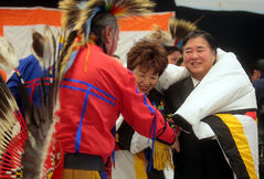Lt.-Gov. Philip Lee and his wife Anita receive a star blanket at the First Nations pavilion during last year's Winter Festival. While the pavilion is not returning for this year's event, Lee will be back, to tap the keg to open the German pavilion.