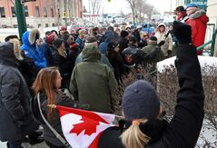 Leita Piché (foreground) raises her fist during a protest of federal cutbacks by military veterans at the federal building on Princess Avenue, Friday afternoon. Brandon's Veterans Affairs office was one of 8 cut by the Harper government in a recent decision.
