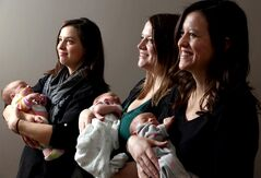 Christmas will be busy for Whitney Johnston, who holds daughter Claire, Sarah Anderson, who holds her son Ben Allen, and Erin Morrison, who holds Liv. The sisters gave birth to three babies less than two weeks apart.