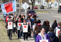 Manitoba Government and General Employees' Union members picket along Victoria Avenue East in front of the Brandon Regional Health Centre over lunch on Tuesday in support of Westman Lab Local 351 workers.