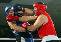 Josh Sealand lands a blow on Brent Jason during the Brandon Boxing Club's Halloween Hustle Amateur  Fight at the Keystone Centre on Saturday evening.