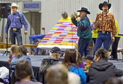 Members of Lewis Auctions conduct the Mennonite Central Committee fundraising auction. In past years, the annual auction, has raised about $125,000.