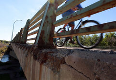 Traffic, two-wheeled and four-wheeled, rumbles over the First Street Bridge in 2012.