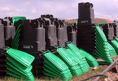 In this May photo, green composting bins are stacked and waiting for delivery at Brandon's Eastview Landfill site.
