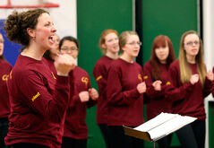 Deanna Ginn directs members of the Crocus Plains Regional Secondary School choir during a performance at Green Acres school yesterday during Music Monday, which highlights the importance of music education across the country.