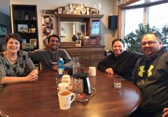 Adrienne Kroeker, left, and her husband Dave hosted their storm-stayed travellers, from left, Subhash Goyal, Paula Cameron and Craig Soldier. They gathered for meals and played dominoes during their stay, as last week's blizzard made highway travel impossible.