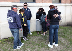 Friends and family members of Duane Lacquette embrace outside the Brandon courthouse on Monday morning after Shilo-based soldier Jason John Ouimet pleaded guilty to manslaughter in the 2010 death of Lacquette.