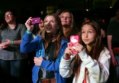Young fans take photos and video as country artists Doc Walker perform at the Souris & Glenwood Memorial Complex during their concert on Friday evening.