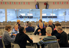 A group of women chat after an afternoon of curling at the Riverview Curling Club on Monday. Help for community clubs was announced in the throne speech.