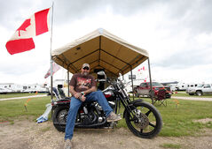Barry Bloomfield, from Gilbert Plains, who has been coming to Dauphin's Countryfest for 24 years, sits on his Harley Davidson motorcycle outside of his campsite. In previous years, Bloomfield has partied with bands like The Road Hammers after their set.