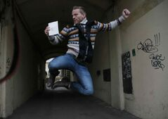 Greenpeace International activist Mannes Ubels of the Netherlands jumps holding his passport as he celebrates getting permission to leave Russia in St. Petersburg. Russian investigators have dropped charges against all of the crew of a Greenpeace ship, who were accused of hooliganism following a protest outside a Russian oil rig in the Arctic.