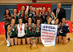 The Neelin Spartans pose with their championship banner and trophy after winning the provincial AAAA varsity girls high school volleyball title on Monday night at the University of Winnipeg's Duckworth Centre. Normally a AAA-sized school, Neelin moved up to AAAA this season and beat MBCI 3-1 (18-25, 25-12, 25-23, 25-20) in the championship final.