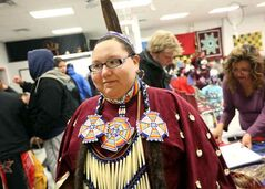 Verna Fiddler-Lynx prepares for her performance at the First Nations pavilion on Friday evening.
