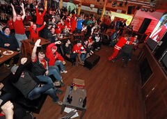 The crowd roars after Canada's third goal during the 3-0 shutout victory.
