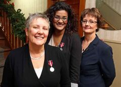 Karen Peto, executive director of the YWCA in Brandon, and national board member Yaso Mathu show off their Queen's Diamond Jubilee Medals as YWCA president Elaine McGregor looks on Thursday afternoon. The pair were given the honours for their work with the women's group.
