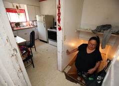 Fiona St. Paul shows her sub-standard housing conditions in Brandon recently. The housing shortage in the Wheat City is having different effects on different people. St. Paul is moving to Sandy Bay First Nation, where she will live in a three-bedroom house already occupied by three other families, until she can find another place to live in Brandon.